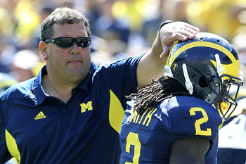 ANN ARBOR, MI - SEPTEMBER 17: University of Michigan Wolverines head coach Brady Hoke congratulates Vincent Smith #2  during the game against Eastern Michigan Eagles at Michigan Stadium on September 17, 2011 in Ann Arbor, Michigan. Michigan defeated Easte