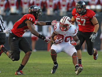 CHICAGO, IL - SEPTEMBER 17:  James White #20 of the Wisconsin Badgers is pursued by Rashaan Melvin #11 of the Northern Illinois Huskies at Soldier Field on September 17, 2011 in Chicago, Illinois. Wisconsin defeated Northern Illinois 49-7.  (Photo by Jona
