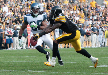 PITTSBURGH - SEPTEMBER 18:  Mike Wallace #17 of the Pittsburgh Steelers catches a pass in front of Earl Thomas #29 of the Seattle Seahawks in the second half during the game on September 18, 2011 at Heinz Field in Pittsburgh, Pennsylvania.  (Photo by Jare
