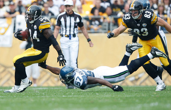PITTSBURGH - SEPTEMBER 18:  Rashard Mendenhall #34 of the Pittsburgh Steelers runs while avoiding a tackle by David Hawthorne #57 of Seattle Seahawks during the game on September 18, 2011 at Heinz Field in Pittsburgh, Pennsylvania.  (Photo by Jared Wicker