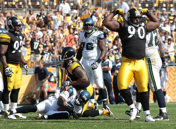 PITTSBURGH - SEPTEMBER 18:  Steve McLendon #90 of the Pittsburgh Steelers celebrates after a sack on Tavaris Jackson #7 of the Seattle Seahawks in the second half during the game on September 18, 2011 at Heinz Field in Pittsburgh, Pennsylvania.  (Photo by
