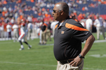 DENVER, CO - SEPTEMBER 18:  Head coach Marvin Lewis of the Cincinnati Bengals watches his team as they warm up prior to facing the Denver Broncos at Invesco Field at Mile High on September 18, 2011 in Denver, Colorado.  (Photo by Doug Pensinger/Getty Imag