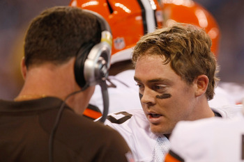 INDIANAPOLIS, IN - SEPTEMBER 18: Colt McCoy #12 of  the Cleveland Browns talks with Pat Shurmur during the game against the Indianapolis Colts at Lucas Oil Stadium on September 18, 2011 in Indianapolis, Indiana. (Photo by Scott Boehm/Getty Images)
