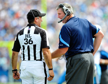 NASHVILLE, TN - SEPTEMBER 18:  Coach Mike Munchak of the Tennessee Titans confers with head linesman Tony Veteri #36 during a game against the Baltimore Ravens at LP Field on September 18, 2011 in Nashville, Tennessee. Tennessee won 26-13.  (Photo by Gran