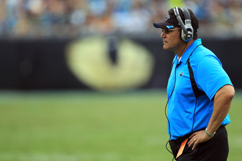 CHARLOTTE, NC - SEPTEMBER 18:  Head coach Ron Rivera of the Carolina Panthers watches on against the Green Bay Packers during their game at Bank of America Stadium on September 18, 2011 in Charlotte, North Carolina.  (Photo by Streeter Lecka/Getty Images)