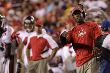 LANDOVER, MD - SEPTEMBER 01: Head coach Raheem Morris throws out the challenge flag during the first half of a preseason game against the Washington Redskins at FedExField on September 1, 2011 in Landover, Maryland.  (Photo by Rob Carr/Getty Images)