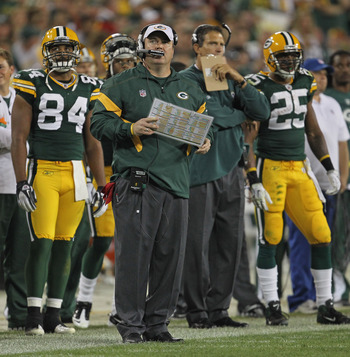 GREEN BAY, WI - SEPTEMBER 08:  Head coach Mike McCarthy of the Green Bay Packers looks up at the replay board during the NFL opening season game against the New Orleans Saints at Lambeau Field on September 8, 2011 in Green Bay, Wisconsin. The Packers defe