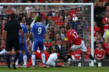 MANCHESTER, ENGLAND - SEPTEMBER 18:  Chris Smalling of Manchester United scores the opening goal during the Barclays Premier League match between Manchester United and Chelsea at Old Trafford on September 18, 2011 in Manchester, England.  (Photo by Clive
