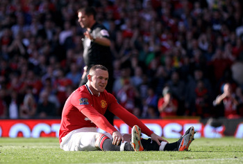 MANCHESTER, ENGLAND - SEPTEMBER 18:  Wayne Rooney of Manchester United reacts after slipping and missing a penalty kick during the Barclays Premier League match between Manchester United and Chelsea at Old Trafford on September 18, 2011 in Manchester, Eng