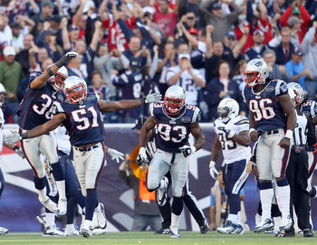 FOXBORO, MA - SEPTEMBER 18:   Jerod Mayo #51 of the New England Patriots is congratulated by Josh Barrett #30 after Mayo made the stop on 4th and less than a yard against the San Diego Chargers on September 18, 2011 at Gillette Stadium in Foxboro, Massach