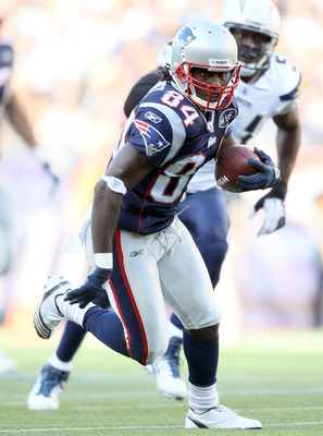 FOXBORO, MA - SEPTEMBER 18:   Deion Branch #84 of the New England Patriots carries the ball in the first half against the San Diego Chargers on September 18, 2011 at Gillette Stadium in Foxboro, Massachusetts.  (Photo by Elsa/Getty Images)