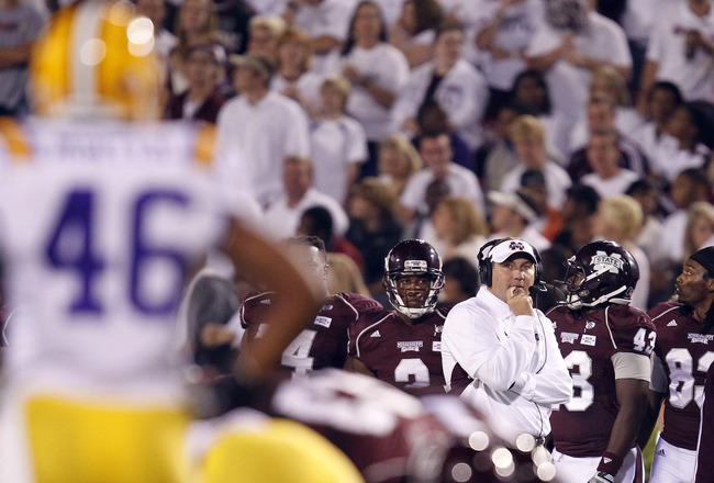 STARKVILLE, MS - SEPTEMBER 15:  Coach Dan Mullens of the Mississippi State Bulldogs watches from the sidelins as they play LSU in the second quarter on September 15, 2011 at Davis Wade stadium in Starkville, Mississippi. (Photo by Butch Dill/Getty Images)