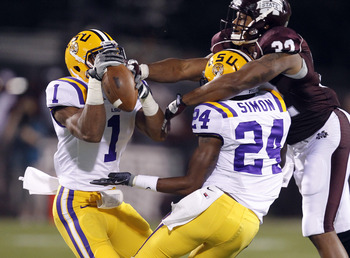 STARKVILLE, MS - SEPTEMBER 15:  Safety Eric Reid #1 of the LSU Tigers and defensive back Tharold Simon #24 of the LSU Tigers break up a pass intended for tight end Marcus Green #32 of the Mississippi State Bulldogs in the second quarter on September 15, 2