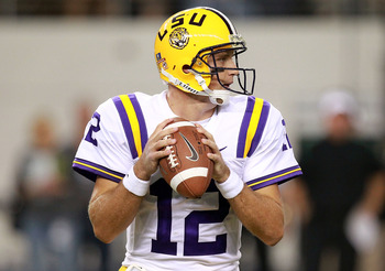 ARLINGTON, TX - SEPTEMBER 03:  Jarrett Lee #12 of the LSU Tigers throws against the Oregon Ducks at Cowboys Stadium on September 3, 2011 in Arlington, Texas.  (Photo by Ronald Martinez/Getty Images)