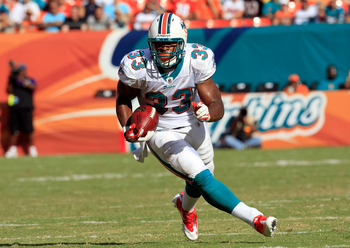 MIAMI GARDENS, FL - SEPTEMBER 18:  Miami Dolphins running back Daniel Thomas #33 runs for yardage during a game against the Houston Texans at Sun Life Stadium on September 18, 2011 in Miami Gardens, Florida.  (Photo by Sam Greenwood/Getty Images)