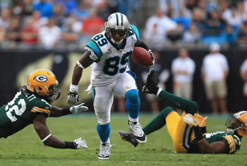 CHARLOTTE, NC - SEPTEMBER 18:   Morgan Burnett #42 of the Green Bay Packers tries to stop Steve Smith #89 of the Carolina Panthers during their game at Bank of America Stadium on September 18, 2011 in Charlotte, North Carolina.  (Photo by Streeter Lecka/G