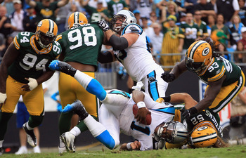 CHARLOTTE, NC - SEPTEMBER 18:   Cam Newton #1 of the Carolina Panthers is tackled by Clay Matthews #52 of the Green Bay Packers during their game at Bank of America Stadium on September 18, 2011 in Charlotte, North Carolina.  (Photo by Streeter Lecka/Gett