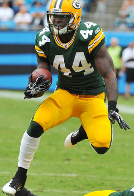 CHARLOTTE, NC - SEPTEMBER 18:  Running back James Starks #44 of the Green Bay Packers rushes upfield against the Carolina Panthers September 18, 2011 at Bank of America Stadium in Charlotte, North Carolina.  (Photo by Al Messerschmidt/Getty Images)