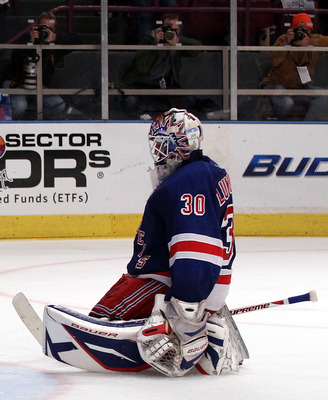 NEW YORK, NY - APRIL 20:  Goalie Henrik Lundqvist #30 of the New York Rangers kneels on the ice dejected after he and the Rangers lost 4-3 in double overtime against the Washington Capitals in Game Four of the Eastern Conference Quarterfinals during the 2