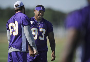 MANKATO, MN - AUGUST 4: Jared Allen #69 and Kevin Williams #93 of the Minnesota Vikings speak during training camp at Minnesota State University on August 4, 2011 in Mankato, Minnesota. (Photo by Hannah Foslien/Getty Images)
