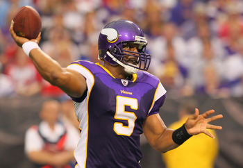 MINNEAPOLIS, MN - SEPTEMBER 18:  Donovan McNabb #5 of the Minnesota Vikings throws against the Tampa Bay Buccaneers at the Hubert H. Humphrey Metrodome on September 18, 2011 in Minneapolis, Minnesota.  (Photo by Adam Bettcher /Getty Images)