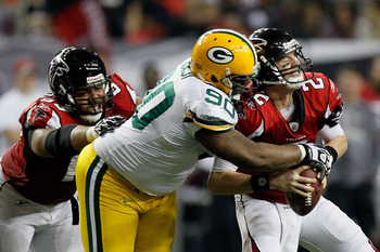ATLANTA, GA - JANUARY 15:  B.J. Raji #90 of the Green Bay Packers sacks Matt Ryan #2 of the Atlanta Falcons during their 2011 NFC divisional playoff game at Georgia Dome on January 15, 2011 in Atlanta, Georgia.  (Photo by Kevin C. Cox/Getty Images)