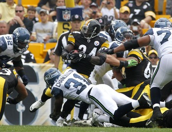 PITTSBURGH, PA - SEPTEMBER 18:   Rashard Mendenhall #34 of the Pittsburgh Steelers scores a touchdown in the first quarter against the Seattle Seahawks during the game on September 18, 2011 at Heinz Field in Pittsburgh, Pennsylvania.  (Photo by Justin K.