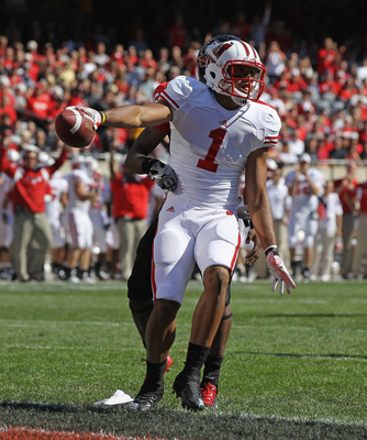 CHICAGO, IL - SEPTEMBER 17:  Nick Toon #1 of the Wisconsin Badgers celebrates a touchdown catch against Jimmie Ward #15 of the Northern Illinois Huskies tries to bring him down short of the goal at Soldier Field on September 17, 2011 in Chicago, Illinois.