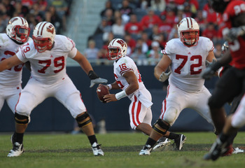 CHICAGO, IL - SEPTEMBER 17: Russell Wilson #16 of the Wisconsin Badgers looks for a receiver as teammates Ryan Groy #79 and Travis Frederick #72 move to block against the Northern Illinois Huskies at Soldier Field on September 17, 2011 in Chicago, Illinoi