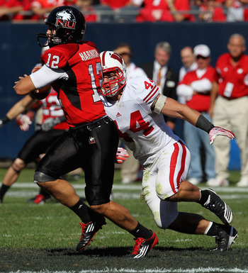 CHICAGO, IL - SEPTEMBER 17: Chris Borland #44 of the Wisconsin Badgers chases Chandler Harnish #12 of the Northern Illinois Huskies at Soldier Field on September 17, 2011 in Chicago, Illinois. Wisconsin defeated Northern Illinois 49-7.  (Photo by Jonathan