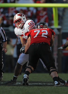 CHICAGO, IL - SEPTEMBER 17: Mike Taylor #53 of the Wisconsin Badgers rushes against Joe Pawlak #72 of the Northern Illinois Huskies at Soldier Field on September 17, 2011 in Chicago, Illinois. Wisconsin defeated Northern Illinois 49-7. (Photo by Jonathan