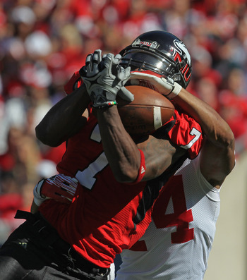 CHICAGO, IL - SEPTEMBER 17: Perez Ashford #7 of the Northern Illinois Huskies catches a pass under pressure from Marcus Cromartie #14 of the Wisconsin Badgers at Soldier Field on September 17, 2011 in Chicago, Illinois. (Photo by Jonathan Daniel/Getty Ima