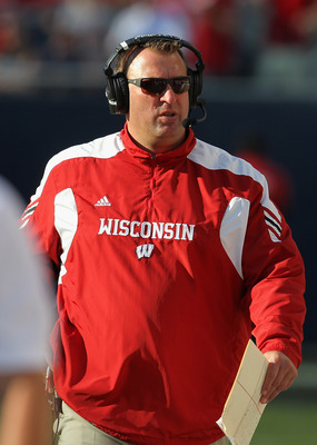 CHICAGO, IL - SEPTEMBER 17:  Head coach Bret Bielema of the Wisconsin Badgers talks on the headset during a game against the Northern Illinois Huskies at Soldier Field on September 17, 2011 in Chicago, Illinois. Wisconsin defeated Northern Illinois 49-7.