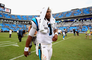 CHARLOTTE, NC - SEPTEMBER 18:  Cam Newton #1 walks off the field after loosing 30-23 against the Green Bay Packers at Bank of America Stadium on September 18, 2011 in Charlotte, North Carolina.  (Photo by Streeter Lecka/Getty Images)
