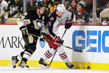 PITTSBURGH, PA - FEBRUARY 8:  Brooks Orpik #44 of the Pittsburgh Penguins checks Anton Stralman #6 of the Columbus Blue Jackets on February 8, 2011 at CONSOL Energy Center in Pittsburgh, Pennsylvania.  (Photo by Jamie Sabau/Getty Images)