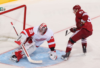 GLENDALE, AZ - APRIL 20:  Goaltender Jimmy Howard #35 of the Detroit Red Wings makes a pad save on the shot from Kyle Turris #91 of the Phoenix Coyotes in Game Four of the Western Conference Quarterfinals during the 2011 NHL Stanley Cup Playoffs at Jobing