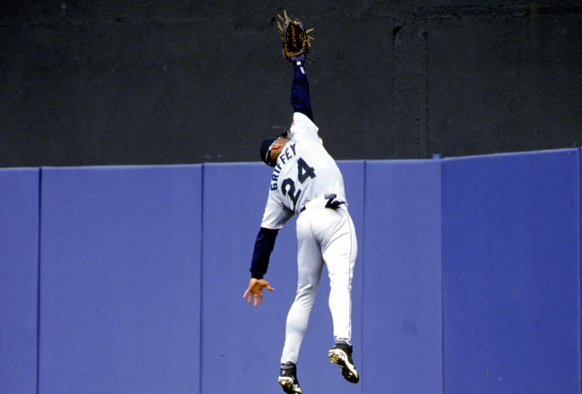 BRONX, NY - JULY 27:  Ken Griffey Jr. #24 of the Seattle Mariners jumps to make a catch during the American League game against the New York Yankees at Yankee Stadium on July 27, 1997 in the Bronx, New York.  The Mariners defeated the Yankees 3-2.  (Photo