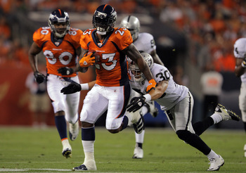 DENVER, CO - SEPTEMBER 12:  Willis McGahee #23 of the Denver Broncos runs the ball as Jerome Boyd #30 of the Oakland Raiders goes for the tackle in the first half at Sports Authority Field at Mile High on September 12, 2011 in Denver, Colorado.  (Photo by