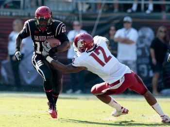 San Diego State running back Ronnie Hillman, left, runs passed the tackle of Washington State's C.J. Mizell, right, during the first quarter of an NCAA college football game, Saturday, Sept. 17, 2011, in San Diego. Photo: Chris Park / AP