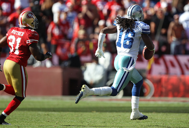 SAN FRANCISCO, CA - SEPTEMBER 18:  Jesse Holley #16 of the Dallas Cowboys runs after a catch in overtime past Donte Whitner #31 of the San Francisco 49ers at Candlestick Park on September 18, 2011 in San Francisco, California.  (Photo by Jed Jacobsohn/Get