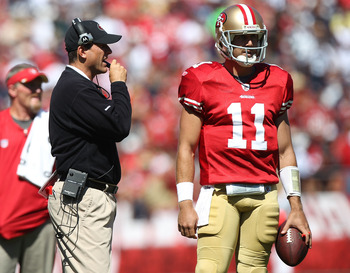 SAN FRANCISCO, CA - SEPTEMBER 18:  Alex Smith #11 of the San Francisco 49ers stands next to head coach Jim Harbaugh during a game against the Dallas Cowboys at Candlestick Park on September 18, 2011 in San Francisco, California.  (Photo by Jed Jacobsohn/G