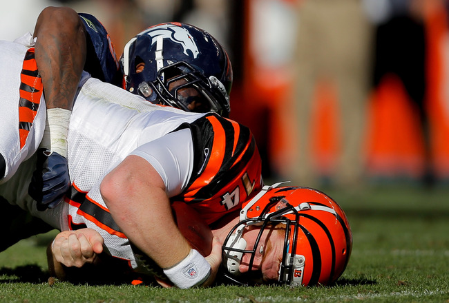 DENVER, CO - SEPTEMBER 18:  Linebacker Von Miller #58 of the Denver Broncos sacks quarterback Andy Dalton #14 of the Cincinnati Bengals during the fourth quarter at Sports Authority Field at Mile High on September 18, 2011 in Denver, Colorado. (Photo by J