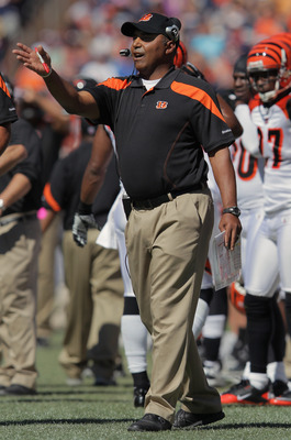 DENVER, CO - SEPTEMBER 18:  Head coach Marvin Lewis of the Cincinnati Bengals leads his team against the Denver Broncos at Invesco Field at Mile High on September 18, 2011 in Denver, Colorado. The Broncos defeated the Bengals 24-22.  (Photo by Doug Pensin
