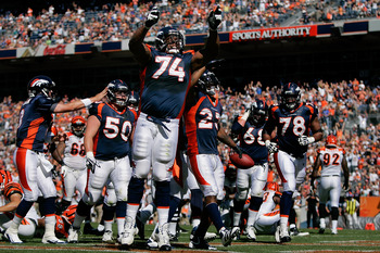 DENVER, CO - SEPTEMBER 18:  Running back Willis McGahee #23 and offensive tackle Orlando Franklin #74 of the Denver Broncos celebrate McGahee's first quarter touchdown against the Cincinnati Bengals at Sports Authority Field at Mile High on September 18,