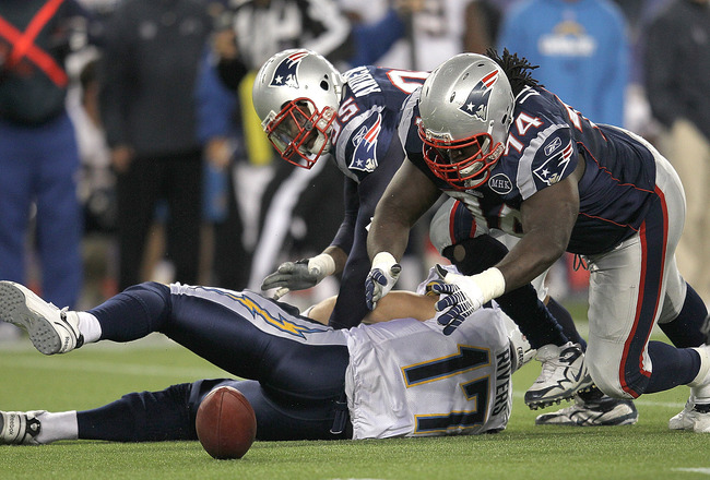 FOXBORO, MA -  SEPTEMBER 18:  Mark Anderson #95 of the New England Patriots sacks  Philip Rivers #17 of the San Diego Chargers as  Kyle Love #74 of the New England Patriots recovers a fumble in the second half at Gillette Stadium on September 18, 2011 in