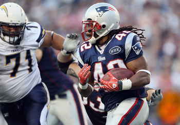FOXBORO, MA - SEPTEMBER 18:   BenJarvus Green-Ellis #42 of the New England Patriots carries the ball as Antonio Garay #71 of the San Diego Chargers defends on September 18, 2011 at Gillette Stadium in Foxboro, Massachusetts.  (Photo by Elsa/Getty Images)