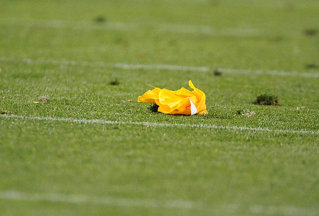 DENVER, CO - SEPTEMBER 12:  A penalty flag lies on the turf during the game between the Oakland Raiders and the Denver Broncos at Sports Authority Field at Mile High on September 12, 2011 in Denver, Colorado.  (Photo by Garrett W. Ellwood/Getty Images)