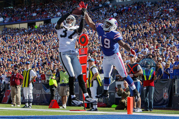 ORCHARD PARK, NY - SEPTEMBER 18: Chris Johnson #37 of the Oakland Raiders misses intercepting a pass intended for Donald Jones #19 of the Buffalo Bills at Ralph Wilson Stadium on September 18, 2011 in Orchard Park, New York. (Photo by Tom Szczerbowski/Get
