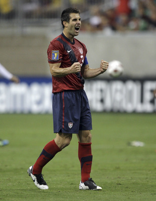 HOUSTON - JUNE 22:  Carlos Bocanegra #3 of the U.S.A. celebrates as the final wihistle blows as the U.S.A. defeated Panama 1-0 at Reliant Stadium on June 22, 2011 in Houston, Texas.  (Photo by Bob Levey/Getty Images)