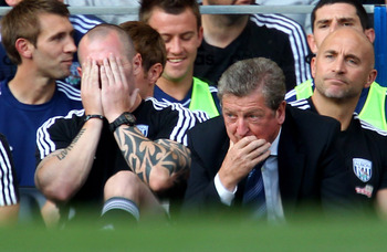LONDON, ENGLAND - AUGUST 20:  A despondant Roy Hodgson the West Brom manager looks on from the dug out during the Barclays Premier League match between Chelsea and West Bromwich Albion at Stamford Bridge on August 20, 2011 in London, England.  (Photo by J